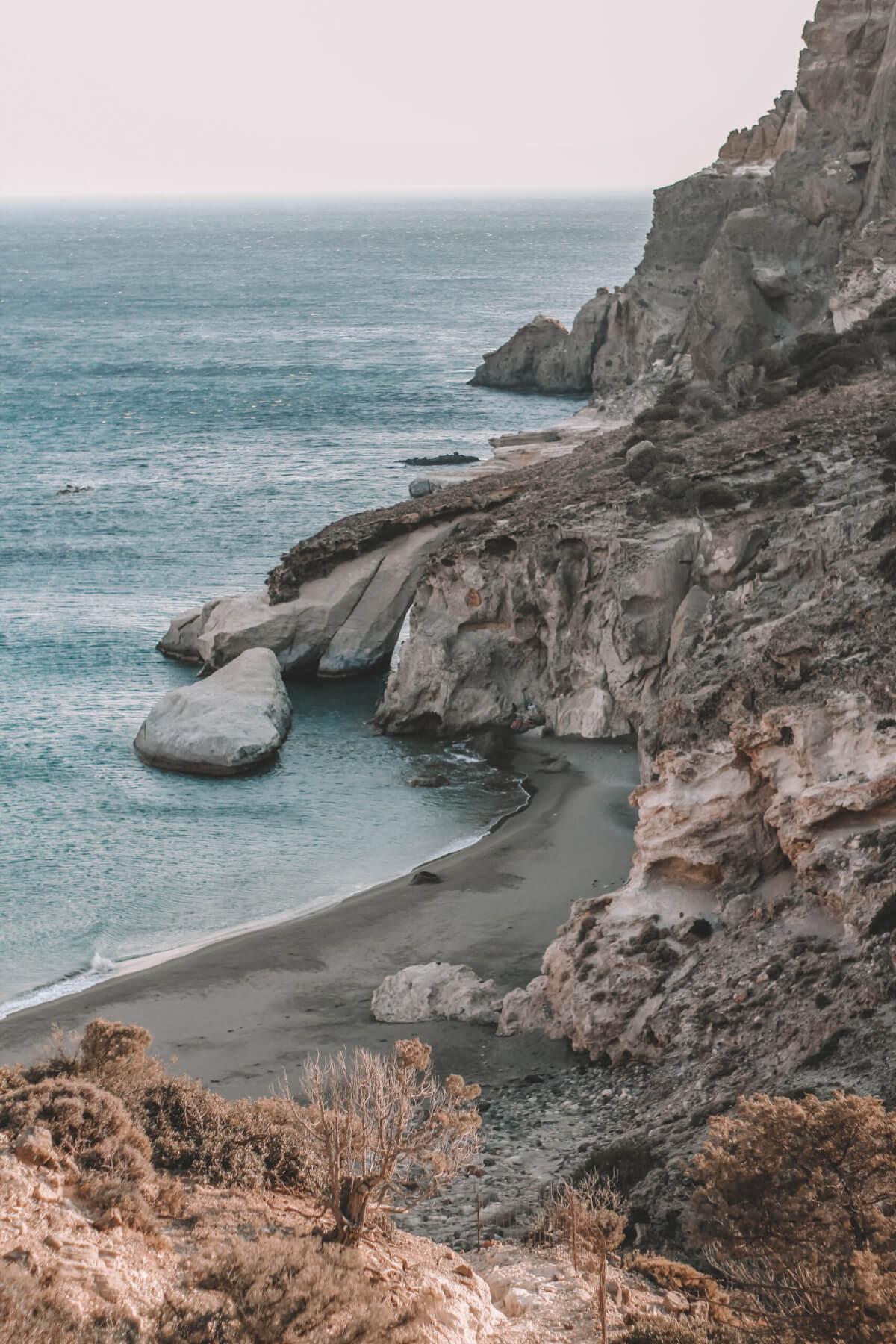 gerontas, milos island, greece, black sand beach, wild beach